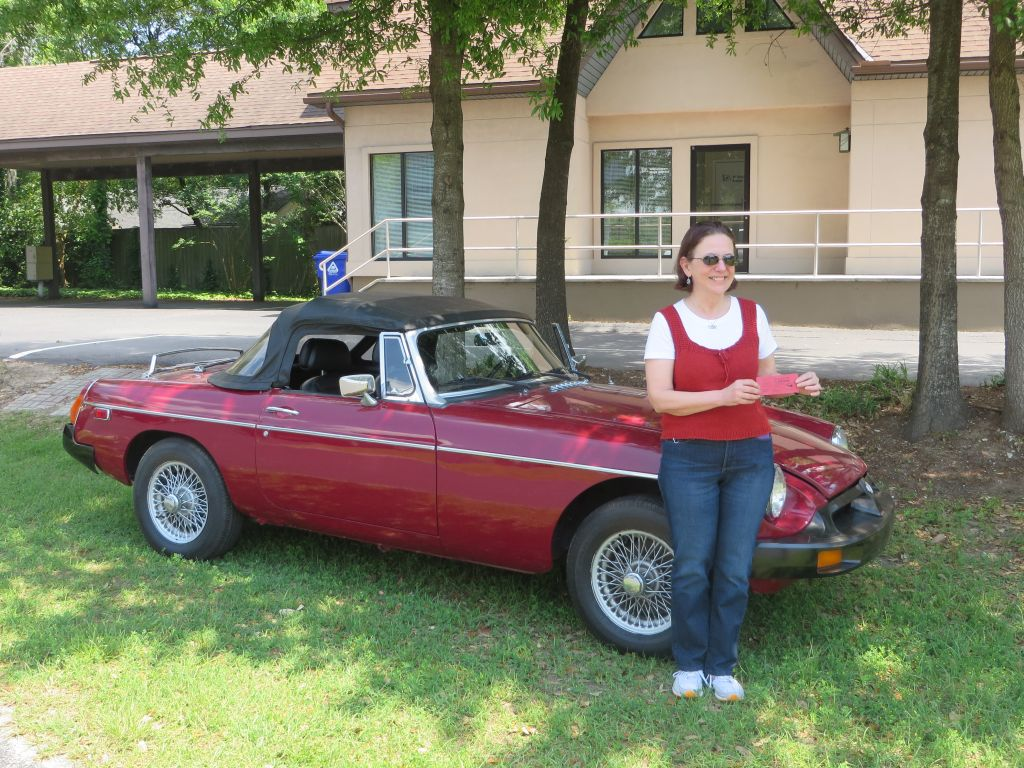 Maria in front of the MGB she won from 2014 BCCC raffle for $20 (she found about $4-5 change in the car that made it even cheaper :-)